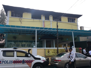 Police and fire department work at the religious school after a fire broke out in Kuala Lumpur, Malaysia. Reuters