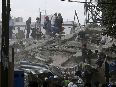 Dozens of buildings tumbled into mounds of rubble in Mexico City and nearby states. AP