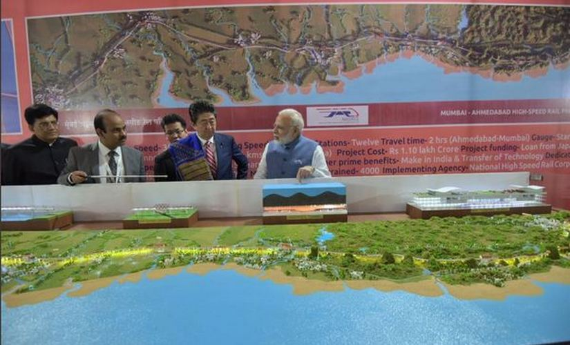 Narendra Modi and Shinzo Abe reviewing map of bullet train's route. Twitter/ @DDNewsLive