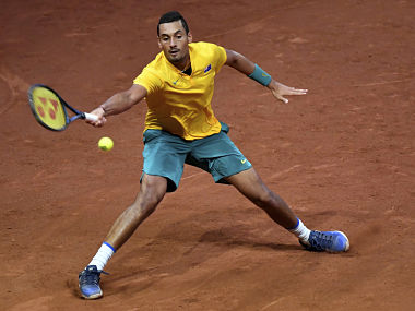 Australia's Nick Kyrgios reaches out to return the ball to Belgium's Steve Darcis. AP