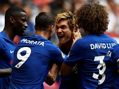 """Soccer Football - Premier League - Tottenham Hotspur vs Chelsea - London, Britain - August 20, 2017 Chelsea's Marcos Alonso celebrates scoring their first goal with team mates REUTERS/Dylan Martinez EDITORIAL USE ONLY. No use with unauthorized audio, video, data, fixture lists, club/league logos or """"live"""" services. Online in-match use limited to 45 images, no video emulation. No use in betting, games or single club/league/player publications. Please contact your account representative for further details. TPX IMAGES OF THE DAY - RC160414C700"""