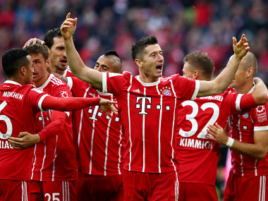 Soccer Football - Bundesliga - FC Bayern Munich vs 1. FSV Mainz 05 - Allianz Arena, Munich, Germany - September 16, 2017 Bayern Munich's Robert Lewandowski celebrates scoring their third goal REUTERS/Michael Dalder DFL RULES TO LIMIT THE ONLINE USAGE DURING MATCH TIME TO 15 PICTURES PER GAME. IMAGE SEQUENCES TO SIMULATE VIDEO IS NOT ALLOWED AT ANY TIME. FOR FURTHER QUERIES PLEASE CONTACT DFL DIRECTLY AT + 49 69 650050 - RC1E0430FF40