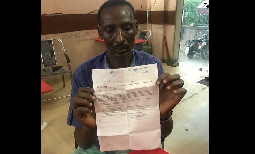 This Somali refugee claims he has spent close to a year waiting for the UNHCR to issue a blue refugee card in his name. He holds out a document that confirms his case is under consideration by the UN. He was earlier a refugee in Kenya and a broker who promised to take him to Australia dumped him in Delhi and vanished. Firstpost/Pallavi Rebbapragada