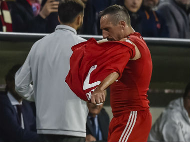 Bayern Munich's French midfielder Franck Ribery takes of his jersey after leaving the pitch during the Champions League group B match between Bayern Munich and RSC Anderlecht in Munich. AFP