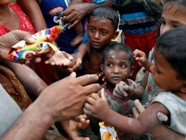 Rohingya refugees get food supplies. Reuters