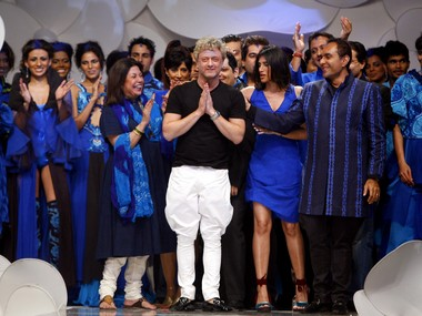 Rohit Bal (C) poses with models and designers. Reuters