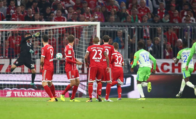 Wolfsburg's Maximilian Arnold scores their first goal from a free kick as Bayern Munich's Sven Ulreich attempts to make a save REUTERS  M
