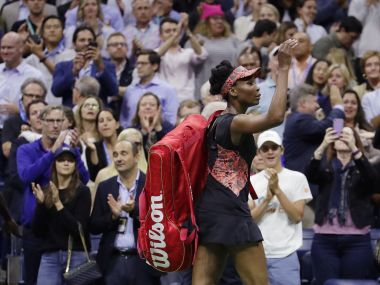 Venus Williams, of the United States, waves to spectators as she walks off the court after losing to Sloane Stephens, of the United States, during the semifinals of the U.S. Open tennis tournament, Thursday, Sept. 7, 2017, in New York. (AP Photo/Julio Cortez)