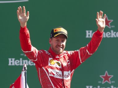 Ferrari driver Sebastian Vettel of Germany celebrates his third place after completing the Italian Formula One Grand Prix, at the Monza racetrack, Italy, Sunday, Sept. 3, 2017. (AP Photo/Antonio Calanni)