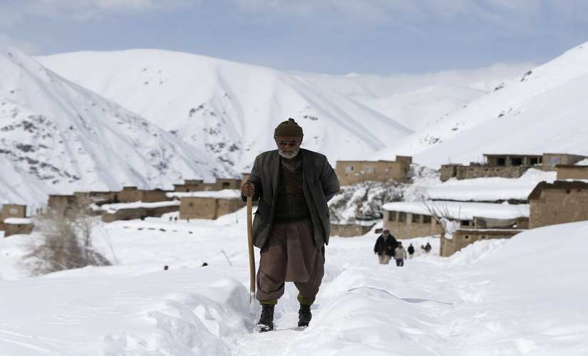 An avalanche victim arrives to receive relief goods in Afghanistan. Reuters