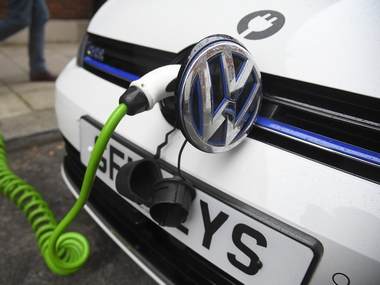 An electric Volkswagen car is plugged into a recharging point. Reuters