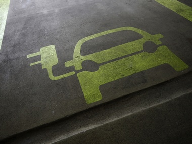 A sign is painted on a parking space for electric cars. Reuters