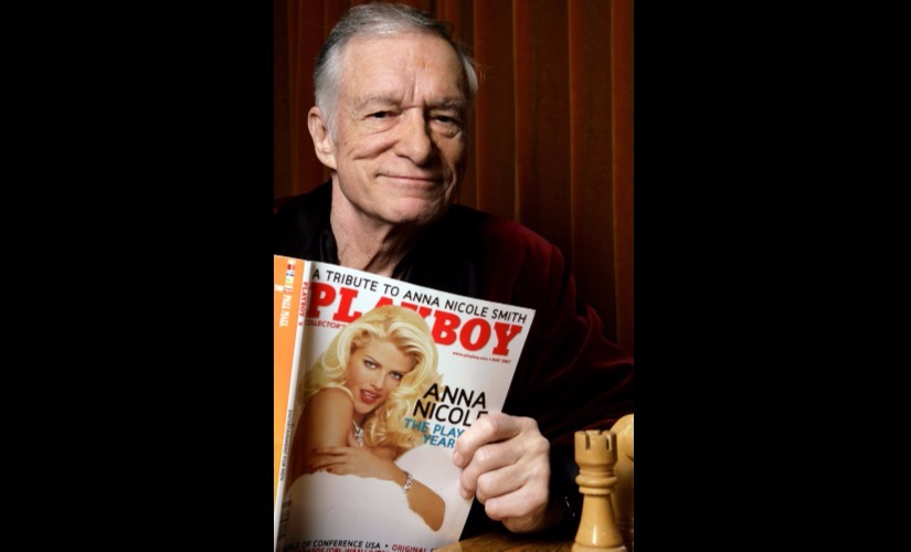 In this April 5, 2007 file photo, Hugh Hefner poses for a photo at the Playboy Mansion in Los Angeles. Playboy magazine founder and sexual revolution symbol Hefner has died at age 91. The magazine released a statement saying Hefner died at his home in Los Angeles of natural causes on Wednesday night, Sept. 27, 2017, surrounded by family. (AP Photo/Damian Dovarganes, File)