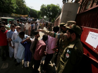 Voters queue outside a polling booth in Lahore. Reuters