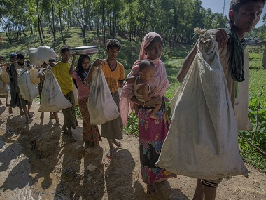 Rohingyas crossing over from Myanmar into Bangladesh. AP