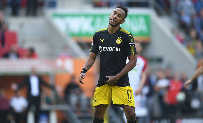 Dortmund's Gabonese forward Pierre-Emerick Aubameyang reacts after a penalty kick during the German first division Bundesliga football match between FC Augsburg and Borussia Dortmund in Augsburg, southern Germany on September 30, 2017. / AFP PHOTO / Christof STACHE / RESTRICTIONS: DURING MATCH TIME: DFL RULES TO LIMIT THE ONLINE USAGE TO 15 PICTURES PER MATCH AND FORBID IMAGE SEQUENCES TO SIMULATE VIDEO. == RESTRICTED TO EDITORIAL USE == FOR FURTHER QUERIES PLEASE CONTACT DFL DIRECTLY AT + 49 69 650050 / RESTRICTIONS: DURING MATCH TIME: DFL RULES TO LIMIT THE ONLINE USAGE TO 15 PICTURES PER MATCH AND FORBID IMAGE SEQUENCES TO SIMULATE VIDEO. == RESTRICTED TO EDITORIAL USE == FOR FURTHER QUERIES PLEASE CONTACT DFL DIRECTLY AT + 49 69 650050