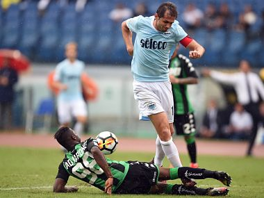 Lazio's midfielder from Bosnia-Herzegovina Senad Lulic contest with Sassuolo defender Claud Adjapong during the Italian Serie A football match. AFP