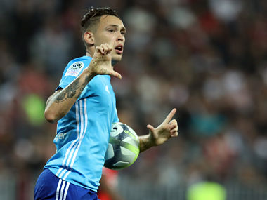 """Olympique de Marseille's Argentinian forward Lucas Ocampos celebrates after scoring a goal during the French L1 football match Nice vs Marseille on October 01, 2017 at the """"Allianz Riviera"""" stadium in Nice, southeastern France. / AFP PHOTO / VALERY HACHE"""