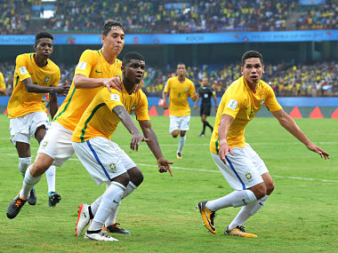 Lincoln (C) of Brazil celebrates after scoring a goal against Spain. AFP