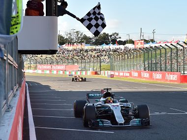 Mercedes' Lewis Hamilton crosses the finish line to win the Japanese Grand Prix at Suzuka. AFP