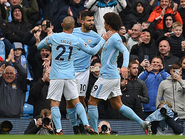 Manchester City's Sergio Aguero (C) celebrates scoring the opening goal from the penalty spot against Burnley, marking his 177th goal for the club. AFP