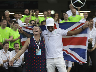 Mercedes' Lewis Hamilton celebrates with his mother Carmen Larbalestier after the Mexico Grand Prix. AP