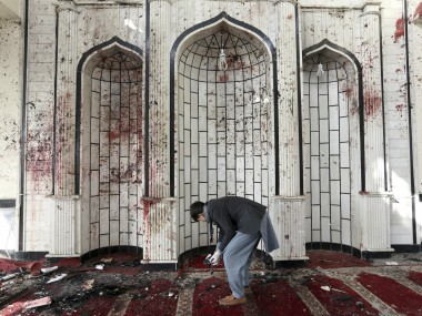 An Afghan man inspects inside a damaged mosque in Kabul, Afghanistan, a day after a suicide attack. AP