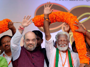 BJP national president Amit Shah and BJP Kerala state president Kummanam Rajasekharan wave to the crowd at the venue of the valedictory of the two-week-long 'Janaraksha Yatra' against the political violence in Kerala allegedly unleashed by the CPM, in Thiruvananthapuram on Tuesday. PTI