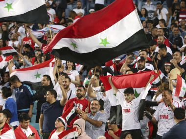 Syrian fans cheer before the start of the World Cup qualifying match between Australia and Syria. AP