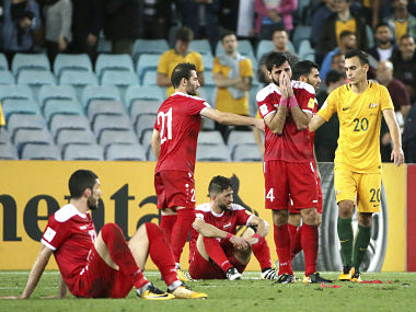 Syrian players react to their loss to Australia in their World Cup qualifying match in Sydney. AP