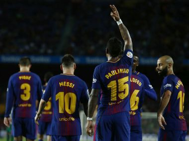 FC Barcelona's Paulinho, center, celebrates after scoring during the Spanish La Liga soccer match between FC Barcelona and Eibar at the Camp Nou stadium in Barcelona, Spain, Tuesday, Sept. 19, 2017. (AP Photo/Manu Fernandez)