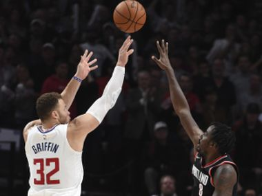 Los Angeles Clippers forward Blake Griffin hits the game winning shot over Portland Trail Blazers forward Al-Farouq Aminu. AP