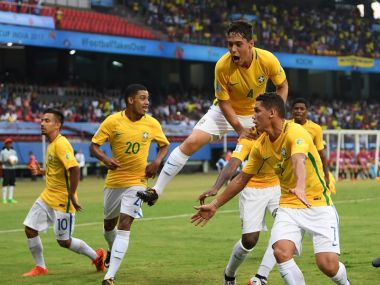 Brazil celebrate after scoring the equaliser in the opener against Spain. Getty