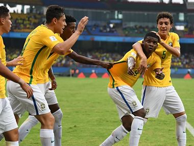 Image of Brazil U-17 football players celebrating a goal during clash with Spain. Getty Images