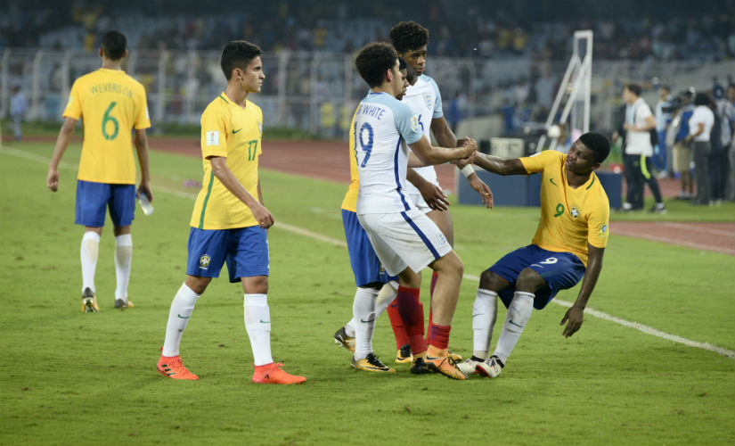 England players console the Brazilians after beating the South American giants in the semi-finals. Getty Images