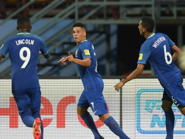 Goalscorer Paulinho of Brazil celebrates with Lincoln and Weverson during their Group D match against North Korea. Getty