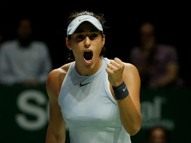 Caroline Garcia celebrates during her group stage match against Elina Svitolina in WTA Finals. Reuters