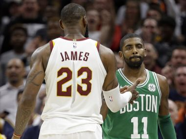 Cleveland Cavaliers' LeBron James and Boston Celtics' Kyrie Irving, right, shake hands after the game. AP