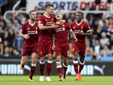 Liverpool's Philippe Coutinho, second from right, celebrates scoring his side's first goal of the game with his team-mates during the English Premier League soccer match against Newcastle at St James' Park, Newcastle, England, Sunday, Oct. 1, 2017. (Owen Humphreys/PA via AP)
