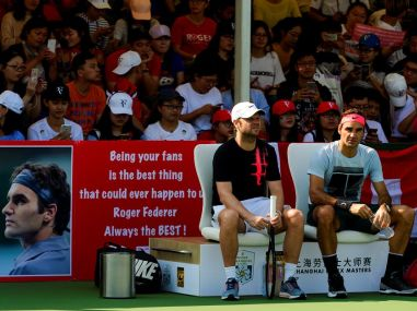 Roger Federer's fans hold up a poster during a practice session at Shanghai. Image courtesy: Twitter @RogerFederer
