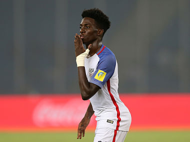USA's Tim Weah celebrates after scoring his third goal against Paraguay in a Round of 16 tie. Getty Images