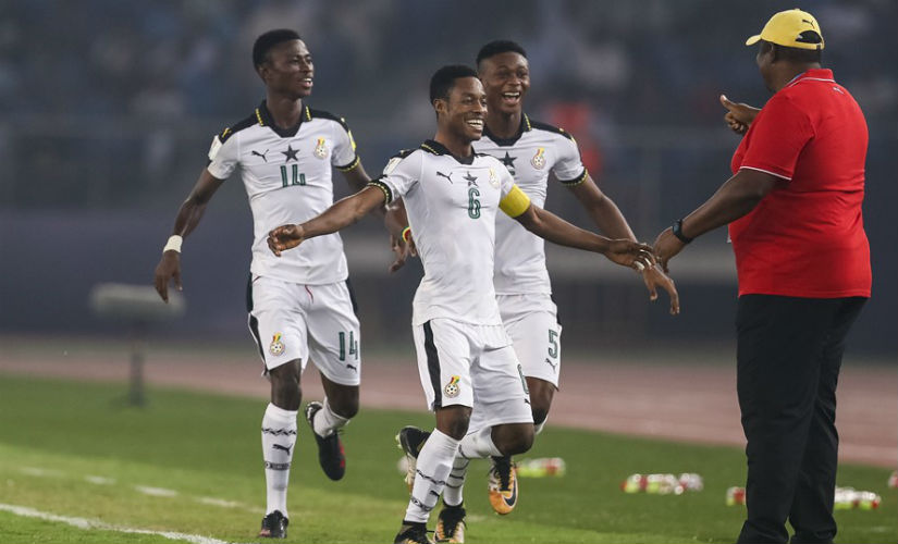 Ghanaian players celebrate with coach Samuel Fabian. Getty Images