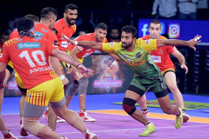 Monu Goyat of Patna Pirates (Green) in action against the Gujarat Fortunegiants during the Pro Kabaddi final. PTI
