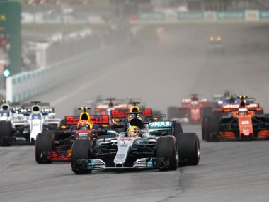 Mercedes driver Lewis Hamilton of Britain leads the field into turn one at the start of the Malaysian Formula One Grand Prix in Sepang, Malaysia, Sunday, Oct. 1, 2017. (AP Photo/Eric To)