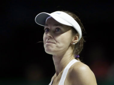 Martina Hingis, paired with partner Chan Yung-jan, reacts after conceding a point during the doubles semifinal match at WTA Finals. AP