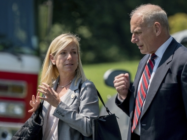 Newly nominated Secretary of Homeland Security Kirstjen Nielsen with White House Chief of Staff John Kelly. AP