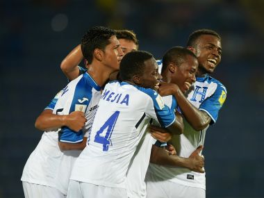 Patrick Palacios (2nd R) of Honduras celebrates with his team after scoring a goal against New Caledonia. Getty