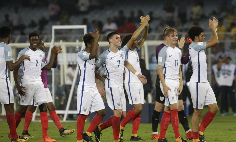 England players celebrate their victory over Brazil in the FIFA U-17 World Cup semi-final. AP