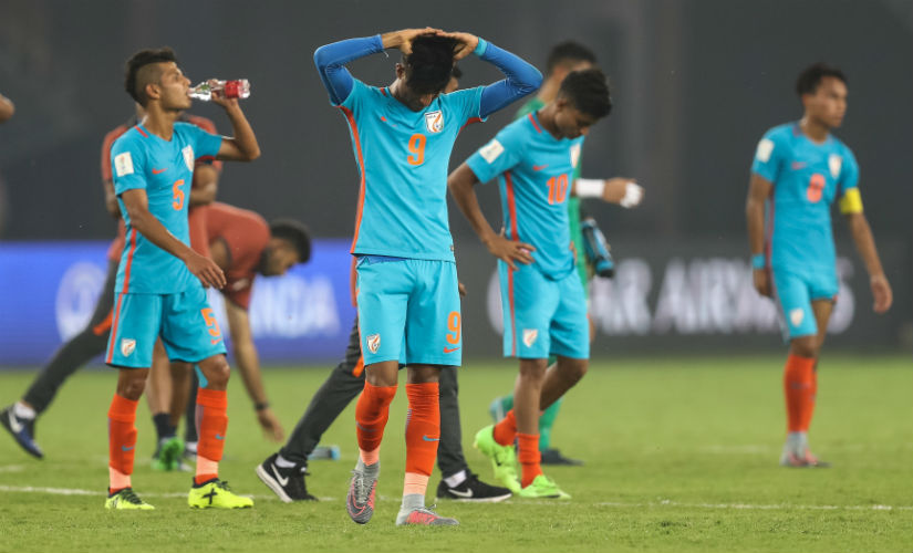 Indian players look dejected after missing out on chances against Colombia. Getty Images