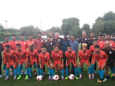 The Indian squad for the U-17 World Cup pose with football legend IM Vijayan days before kickoff. Image credit: Twitter/@IndianFootball